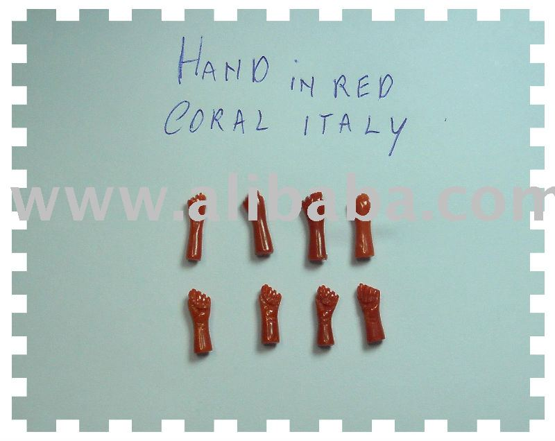 carving of hand in red coral italy