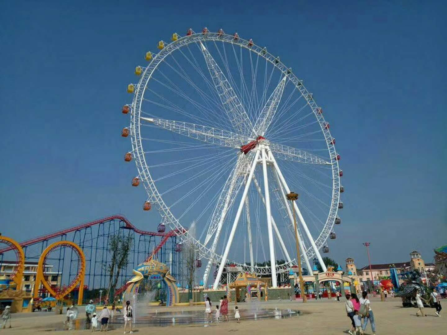 A Ferris wheel sometimes called in the case of the very tallest examples giant wheel is an amusement ride consisting of a rotating upright wheel with multiple