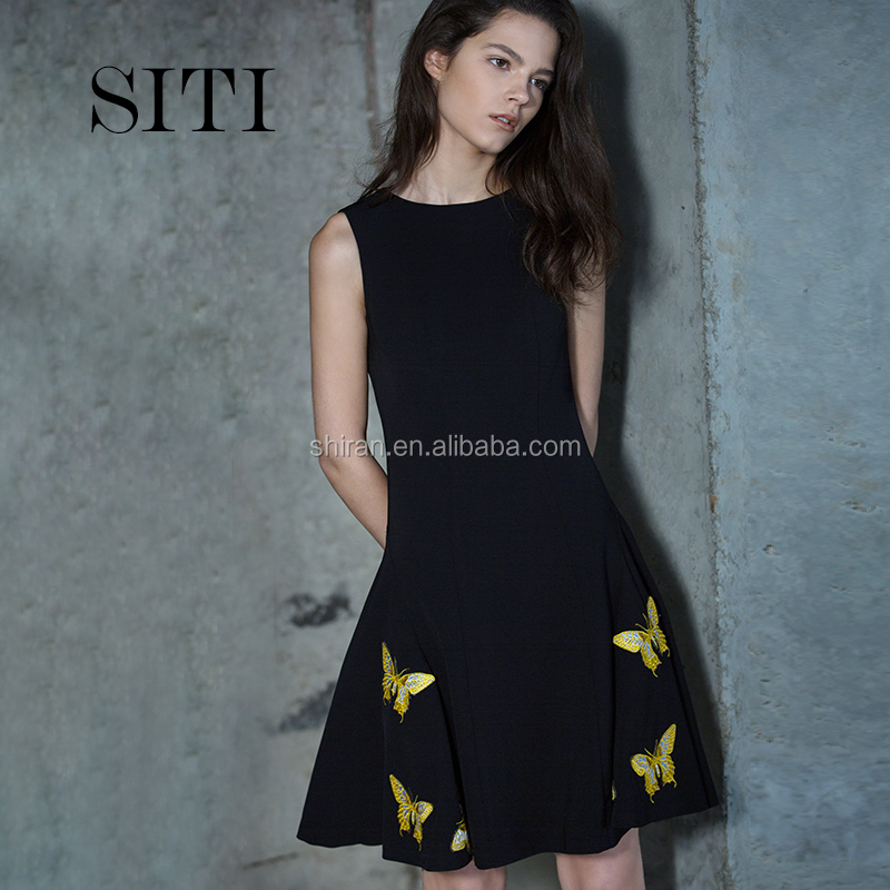 Lady's black sleeveless dress with embroidered cocktail dress