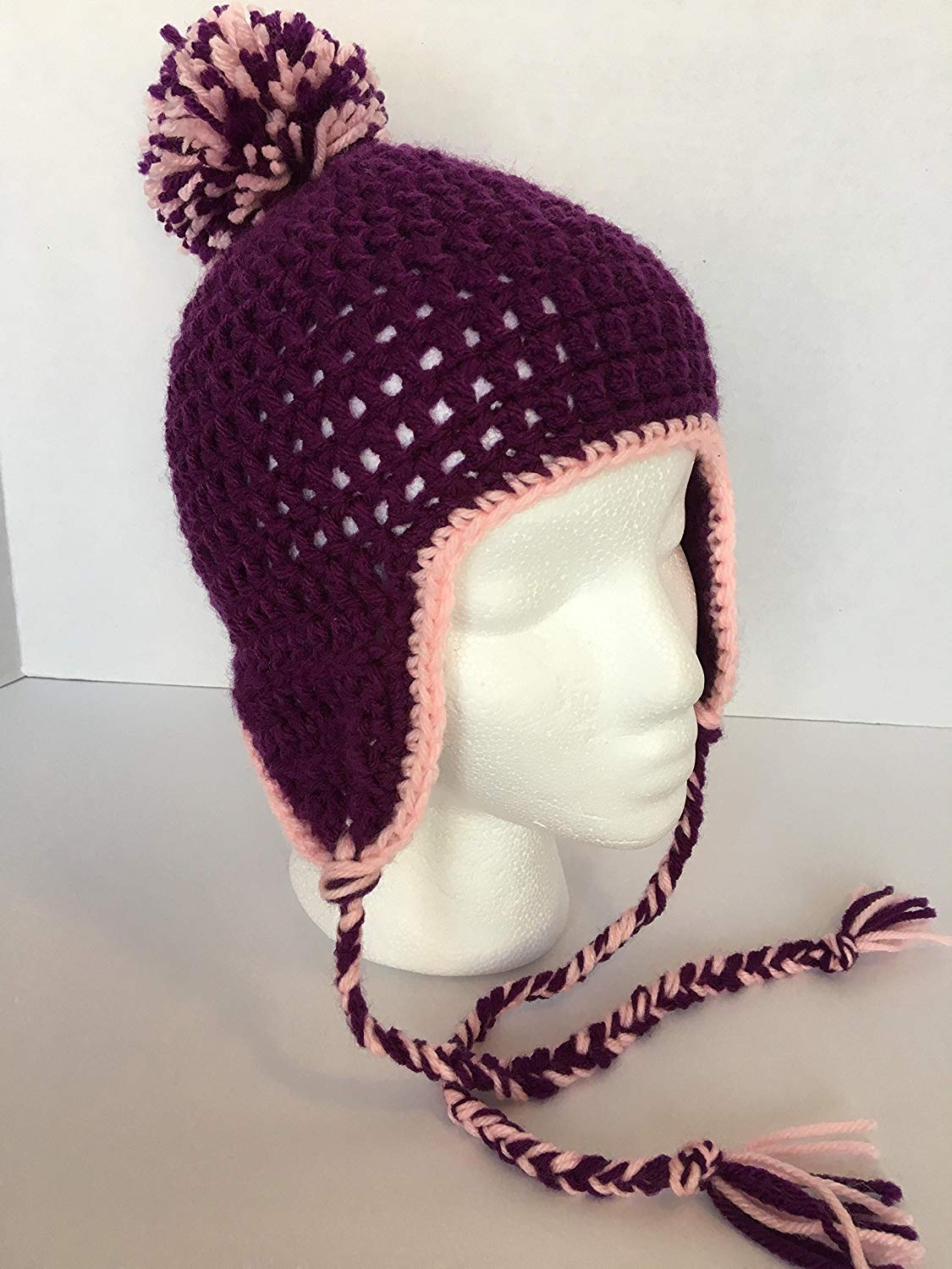 """New, Handmade Crocheted Little Girl's Beanie with Ear Flaps, Purple with Pink Trim, Purple & Pink Pom Pom, with Braided Ties, hat measures 20"""" in circumference, & 7""""' from crown to brim."""