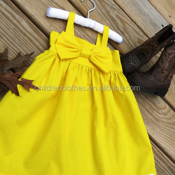 Yellow boutique baby dresses