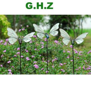 Metal garden ornaments type luminous butterflies on sticks for Garden decking ornaments
