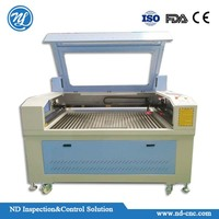 High speed laser engraving and cutting machine NDJ1390-130W for wood working.