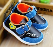 2014 new children's spring shoes wholesale USES splicing children's recreational leather shoes The single goose bottom boy shoes