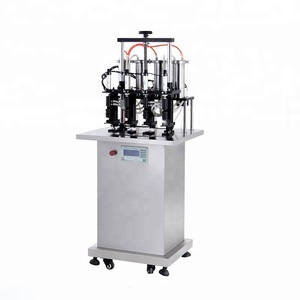Four head semi automatic vacuum perfume bottle filling filler machine