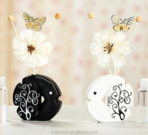 Fish Shape Flower Diffuser Ceramic Diffuser Bottle with Sola Flower and Wood Beads & Butterfly on Rattan Reed Sticks