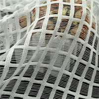 Innovative Polyester Nonwoven Checked Mesh Fabric