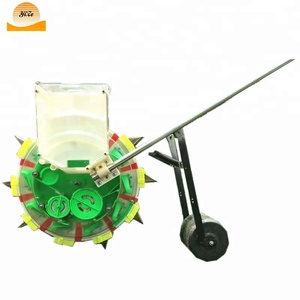Hand operate manual corn bean seeder / grain peanut seeding machine width adjustable
