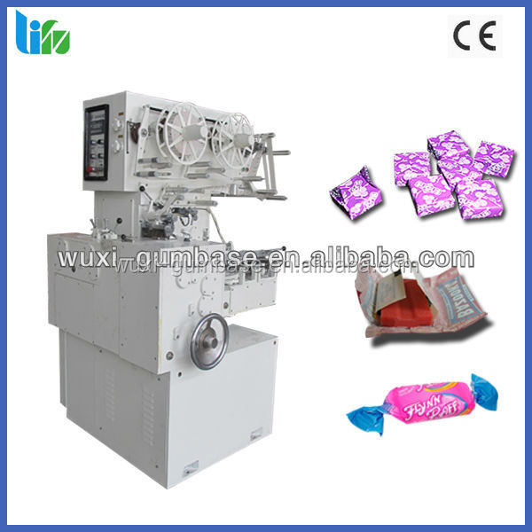 TOFFEE CUTTING AND DOUBLE TWIST PACKING MACHINE