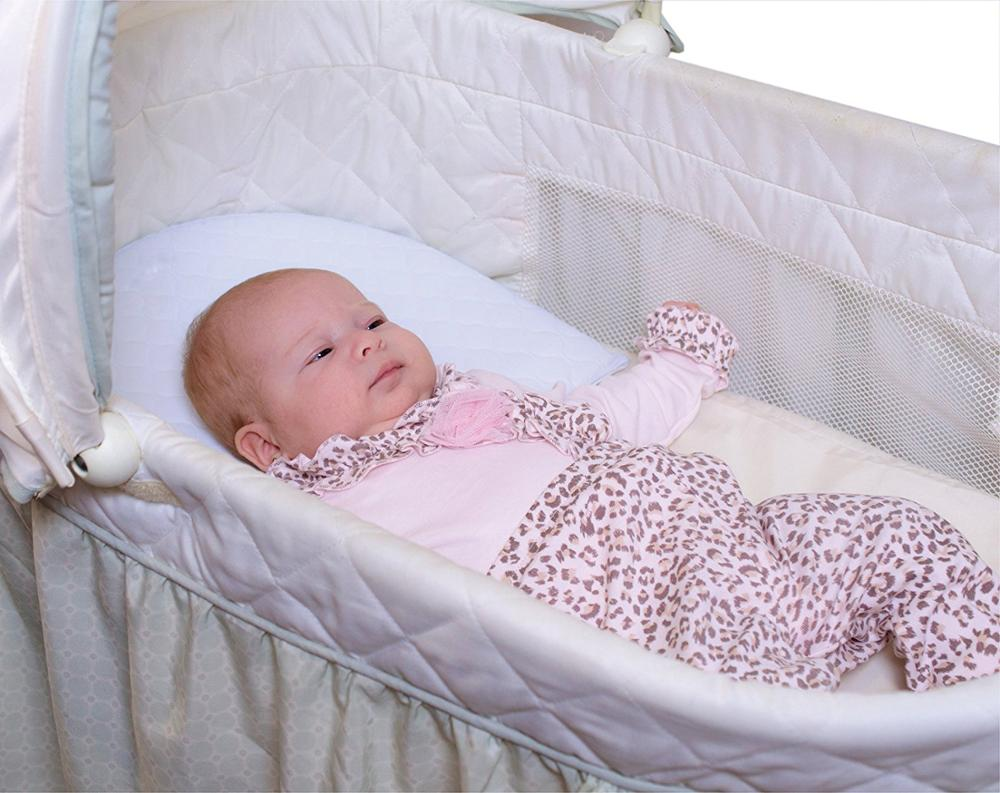this infant wedge pillow is designed to solve these problems