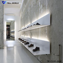 Free design modern acrylic solid surface retail shoes display rack and stand