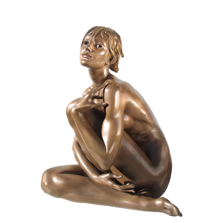 Small figurative nudes in bronze male and female by teresa wells sculptor seen