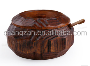 Set hand-carved wooden bowl of rice a bowl of shells texture spoonful