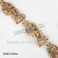 Bone 23x57x10mm carved skull beads