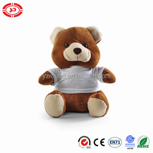 Brown teddy cute bear wear white t-shirt sitting adorable safe standard toy