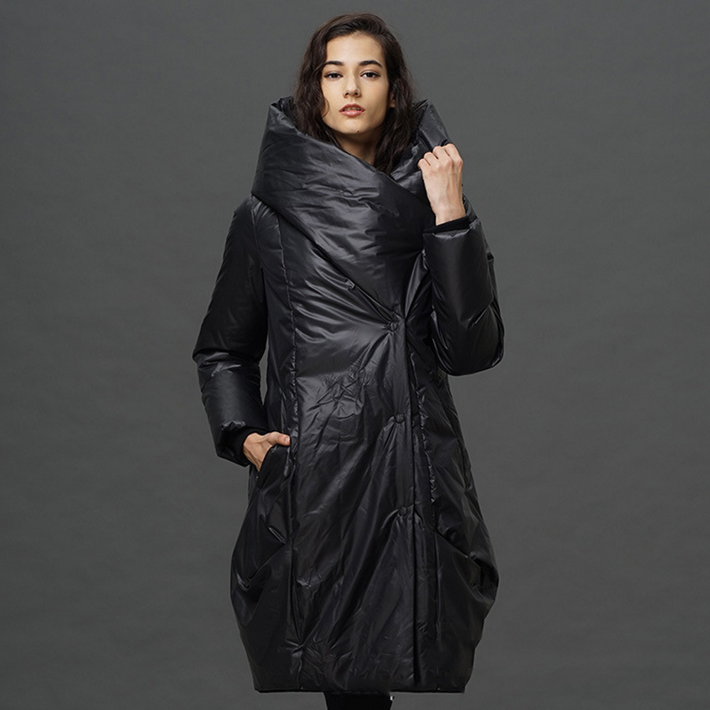 constructed from water repellent 60/40 duck down filled fabric, the imogene is a reversible parka featuring a clean black silhouette on one side and colorblocked chevron quilting on the other for days when you want your jacket to do the talking for you.