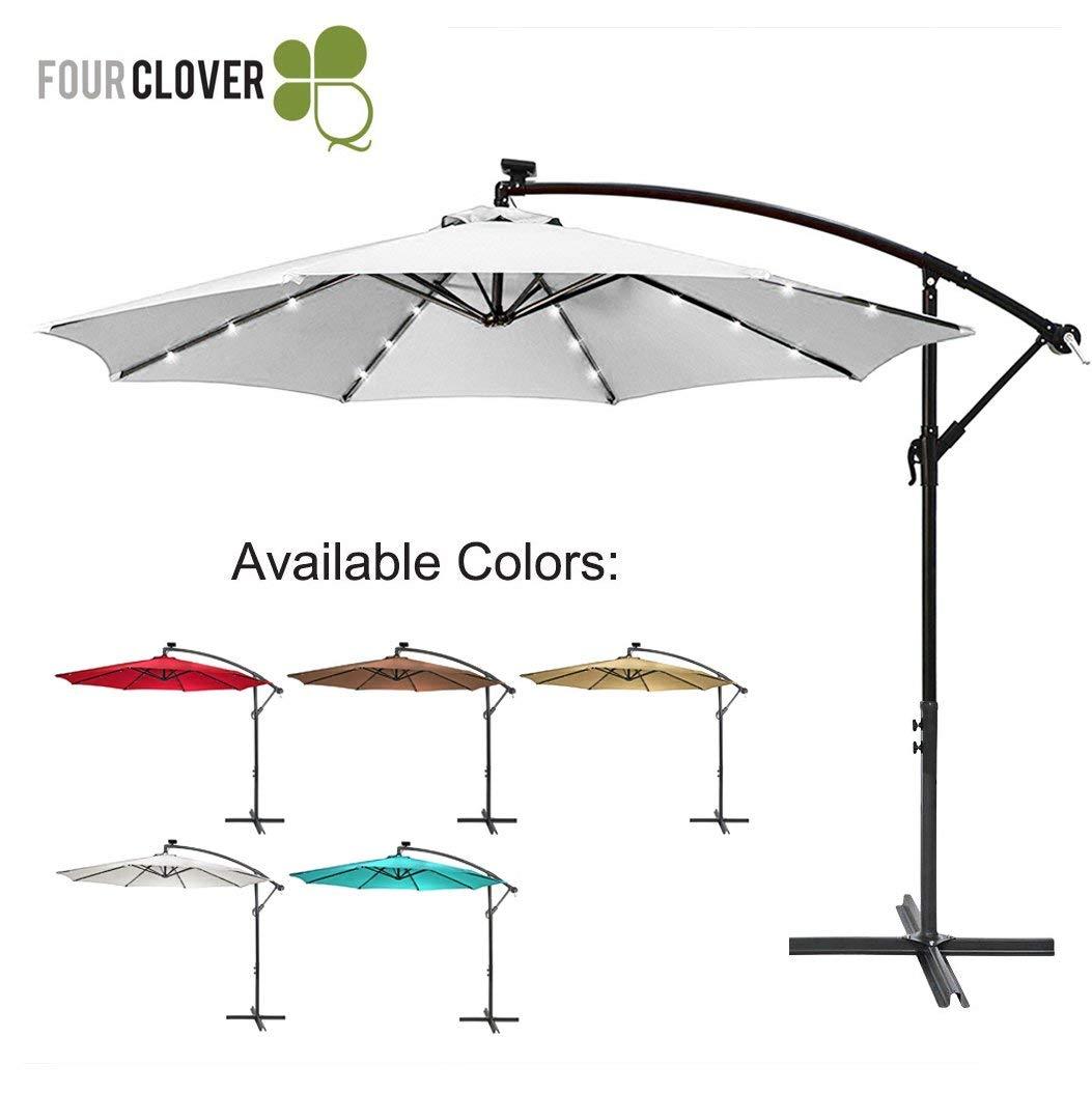 FOUR CLOVER 10 Ft Deluxe Solar 32 LED Lighted Patio Umbrella Offset Hanging Umbrella Outdoor Market Umbrella Garden Umbrella, 250g/sqm Polyester, with Cross Base and Crank (White)