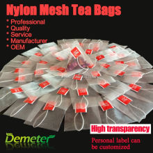 Empty pyramid nylon tea bag with string and tag