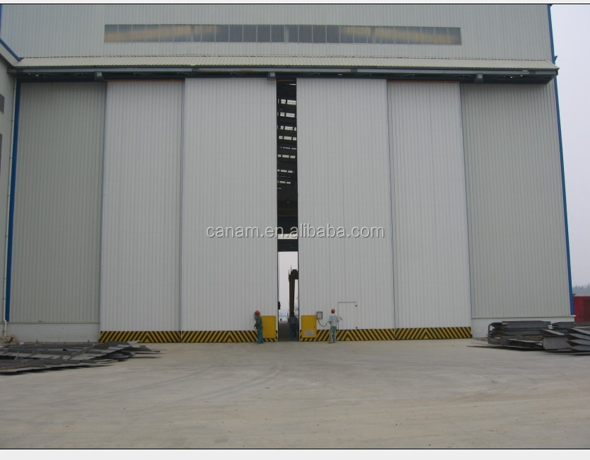 China Supplier Industrial Electric Sliding Folding Door