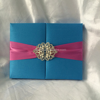 silk wedding invitation with custom brooch closure and foil printed