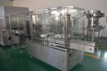 Automatic table top liquid filling machine