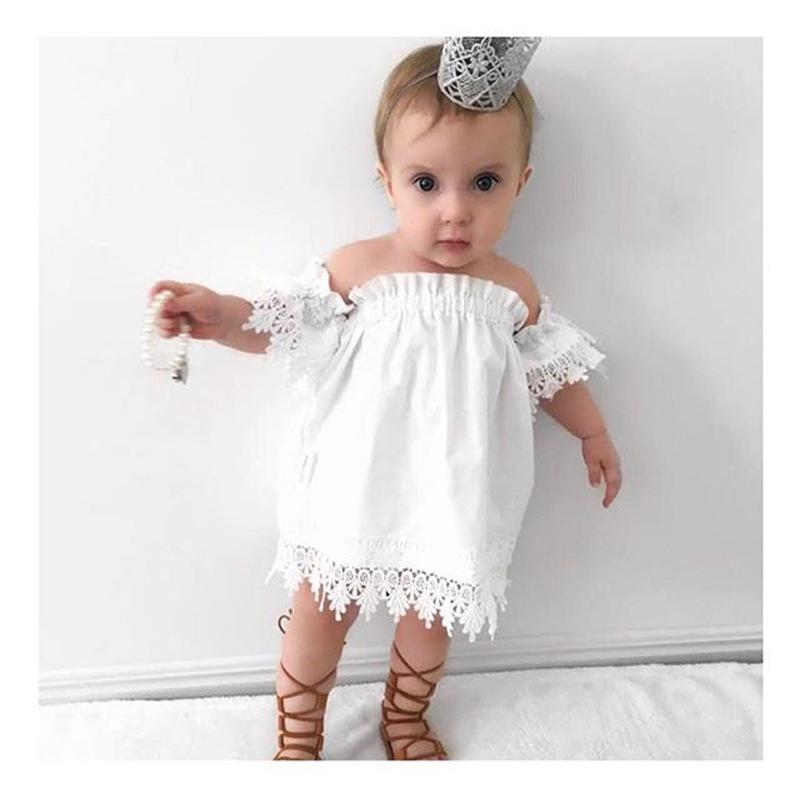 Robe en laine blanche bebe