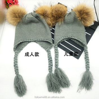 Promotional winter women and children knitted beanie hats with double fur  balls earmuffs pompom pigtails hats 4a4652504a8