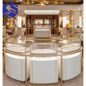 Wholesale round glass jewelry display table for jewellery shop design