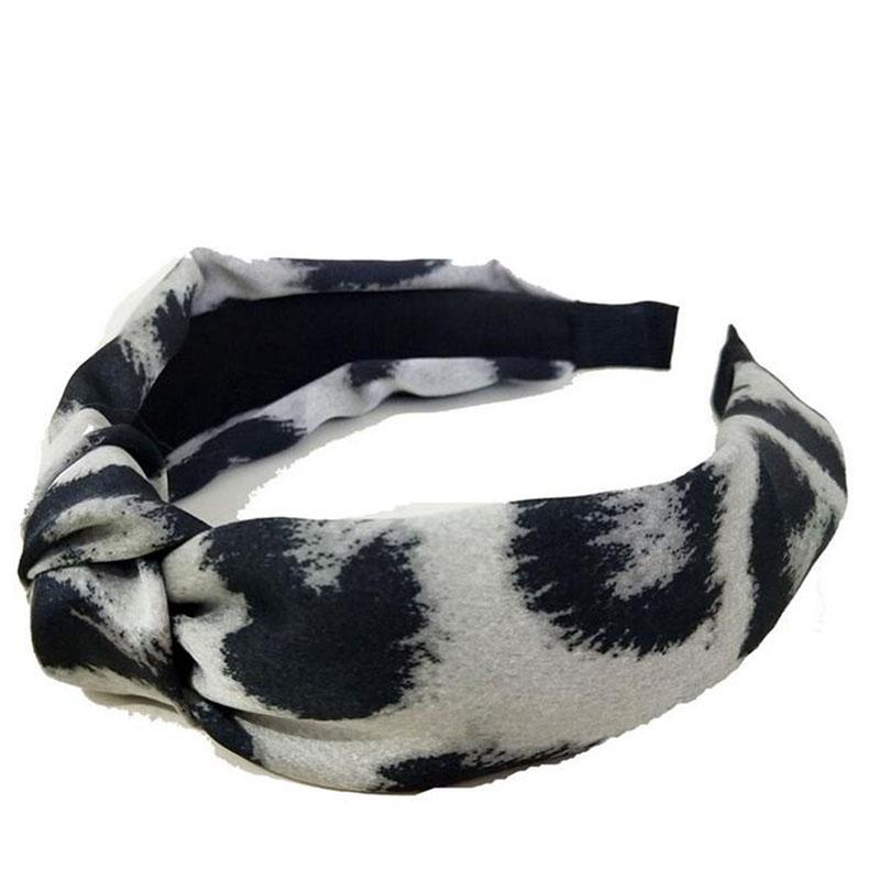 e657c66e6b37 Otoño y el invierno de la moda Popular personalidad Color leopardo arco  nudo Cruz diadema pelo