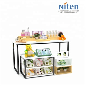 Niten design wood counter design cosmetics shop interior skin care product display for advertising