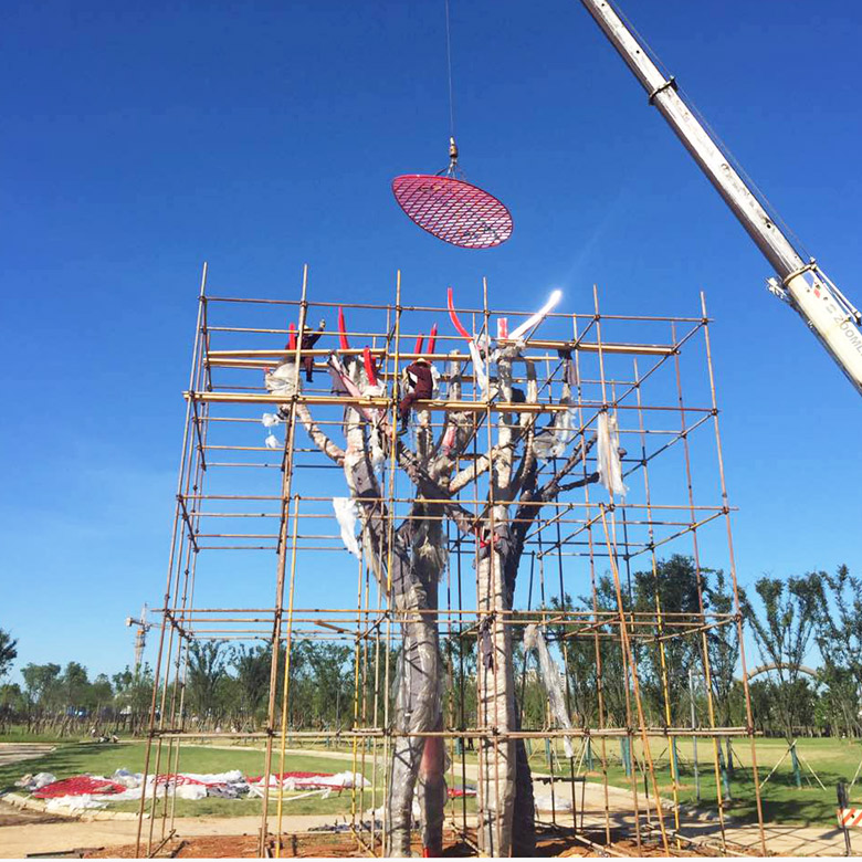 Large outdoor stainless steel tree sculpture in Resorts park