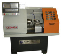 The small cnc lathe machine with chuck and tool turret CK0640A