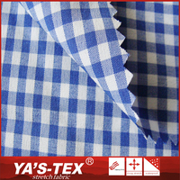 Fashion style polyester plain woven yarn dyed stretch chambray fabric for man shirt