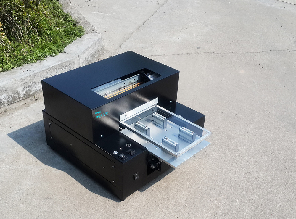 Automatic flatbed printing machine a4 size very nice for T shirt printing pdf