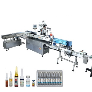 Automatic ampoule labeler applicator machine with tray inserting system
