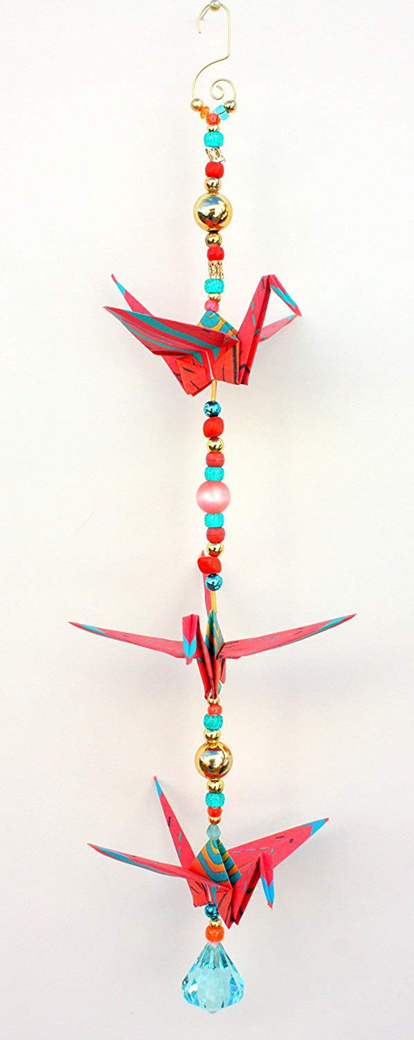 """Good Luck"" Southwestern Zia Sun design crane mobile for indoor decor approx. 18"" high and 5.5"" wide. A unique handmade origami accent piece."