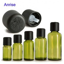 Alibaba 5ml 10ml 15ml 30ml 50ml Olive Light Green Glass Essential Oil Bottle Anointed Glass Bottle with Black Press Screw Cap