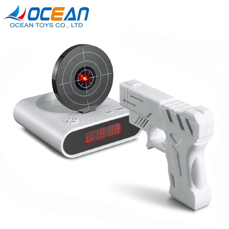 Nuovo disegno pigro sveglia orologio gun shooting target alba sveglia per la vendita