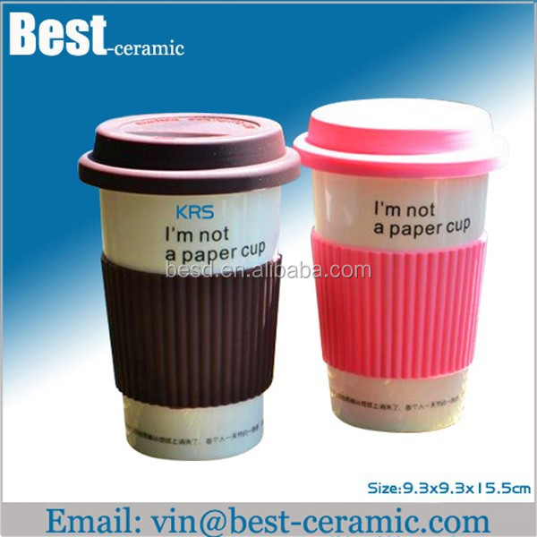 ceramic take away travel mug with silicone lid and sleeve
