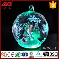 lighted glass globe decoration with owl and forest inside
