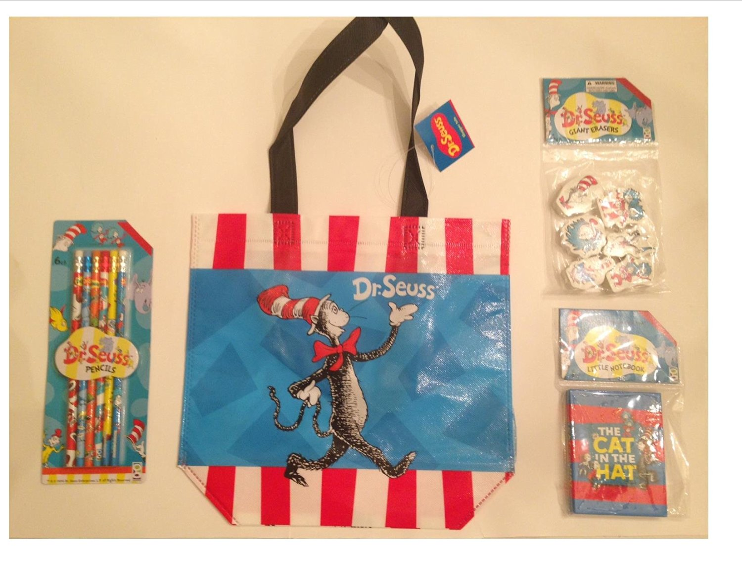 Dr. Seuss The Cat in the Hat Themed Back to School Supply Kit. This 4 Piece Bundle Includes a Mini Shopper Tote, Pencils, Erasers, Little Notebook. Perfect for Teachers Supply, Day Care, Pre-School, Pre-K, Kindergarten, and Elementary School Students.
