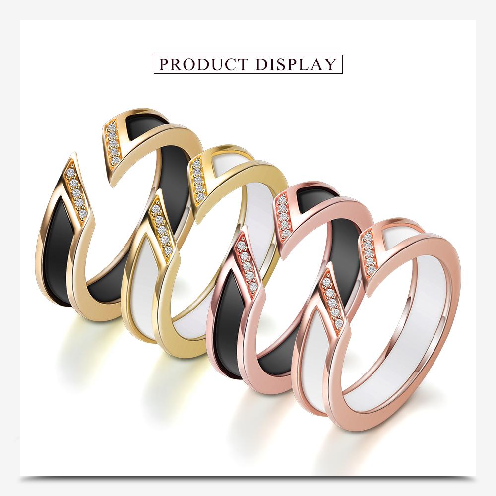 2d5bc30a0163 Blanco anillo de cerámica con una fila de Australia de canal Rosa-de Metal  de