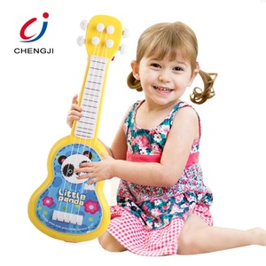 Cheap battery musical educational kids miniature toy guitar with microphone