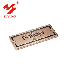 Stamped metal sewing charms tag with custom logo in Guangzhou