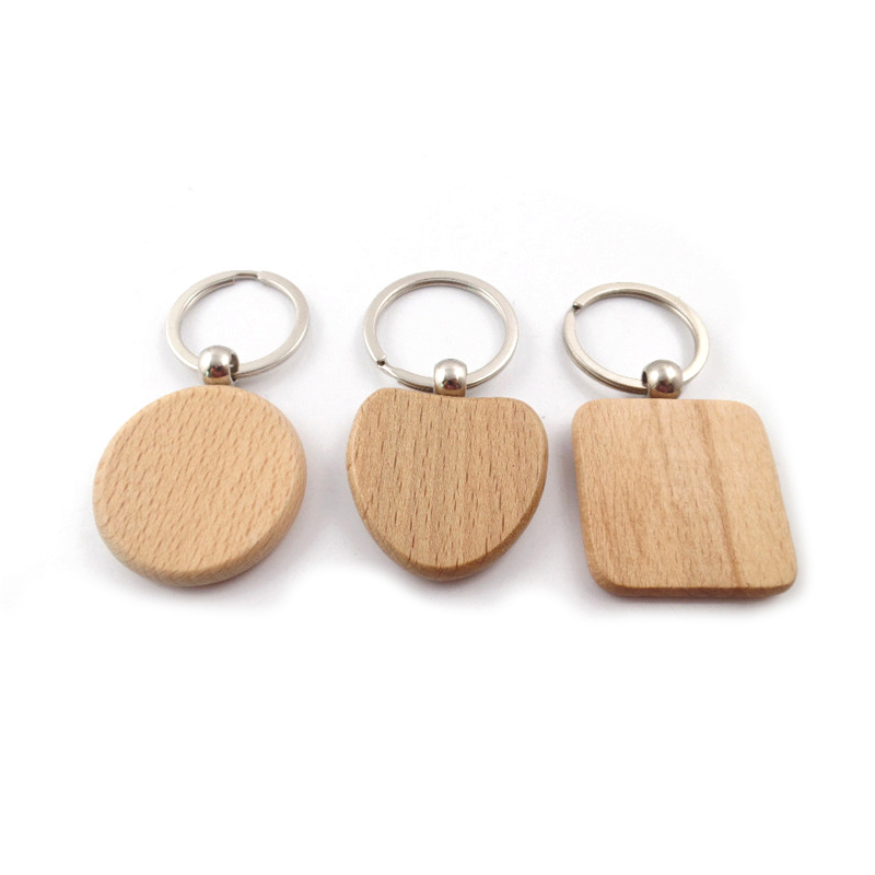 Fashionable Multi shaped wooden keychain pendant can be customized blank wood keyholders