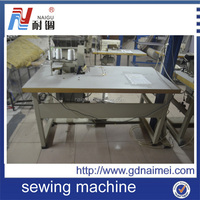Tape edge sewing machine