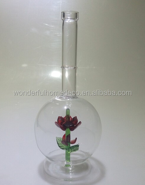 whiskey glass bottle with green sculpture inside