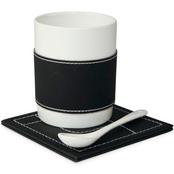 black and white coffee set with leather sleeve and cushion