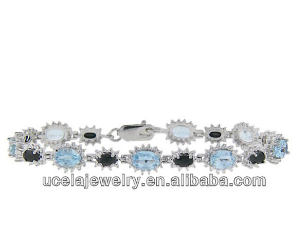 Sterling Silver Sapphire, Blue Topaz and Diamond Accent stretch Gemstone Bracelet