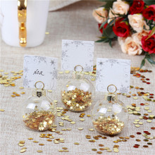 Clear glass bauble wedding place card holder with metallic Star
